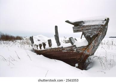 Boat skeleton on White sea shore