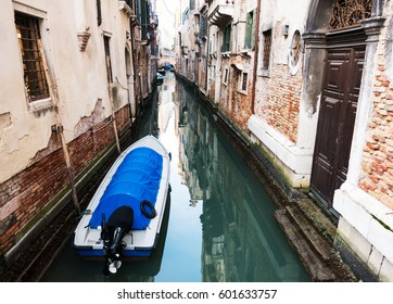 A boat in a small canal of Venice, Italy