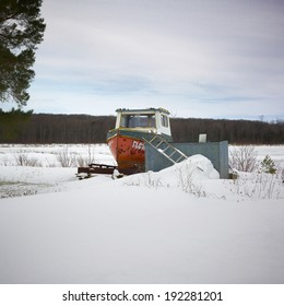 Boat in a snow covered landscape, Orangeville, Dufferin County, Ontario, Canada