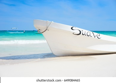 "Boat with the spanish word ""suave"" that stands for ""soft"" at Mexican Paradise Beach next to Tulum / Boat at caribbean beach in Mexico / Exotic background"