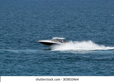Boat speeding in lagoon in Mauritius