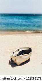 Boat standing on the beach - mobile wallpaper