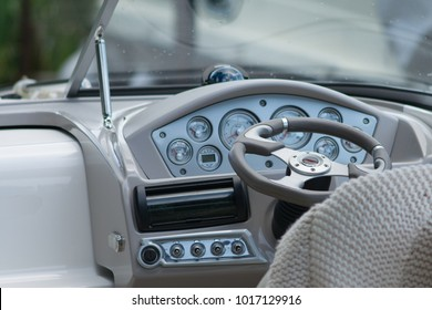 boat steering wheel with controls and windscreen