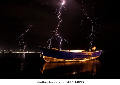 Boat with storm lightning background. Durres Albania 2019