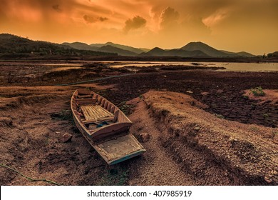 Boat stranded in the desert at sunset, During the summer this area is flooded and fishing takes place in the dry winter months