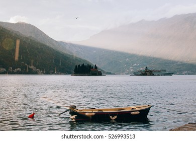 A boat and sunny and rainy Montenegro