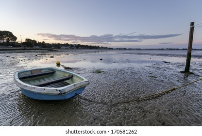 Boat at sunrise at Sandbanks beach in Poole, Dorset
