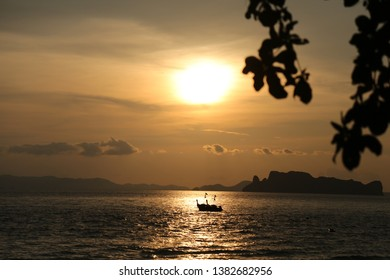 boat with sunset at krabi thailand beach