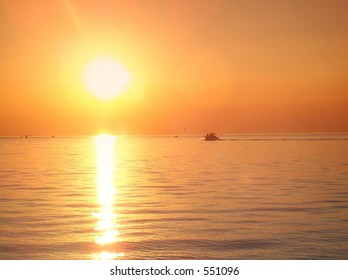 A boat at sunset on Lake Ontario.