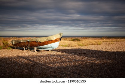 Boat at sunset on the shore at Kessingland on the Suffolk coast, UK