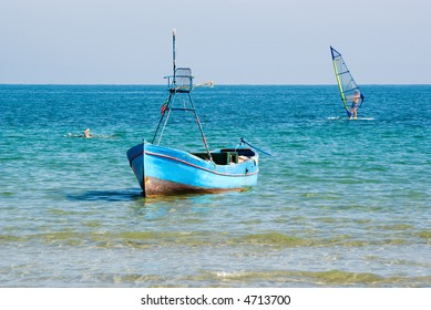 Boat, Surf and Swimmer