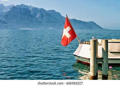 Boat with Swiss flag at Geneva Lake in Montreux, Vaud canton, Switzerland