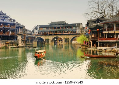 Boat tour in Fenghuang old city (Phoenix Ancient Town),Hunan Province, China by Tuojiang River.
