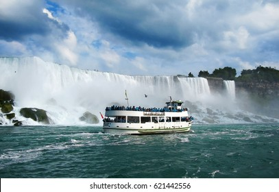 The boat with tourists eager to see the nature miracle in front of Niagara Bridal Veil Falls.
