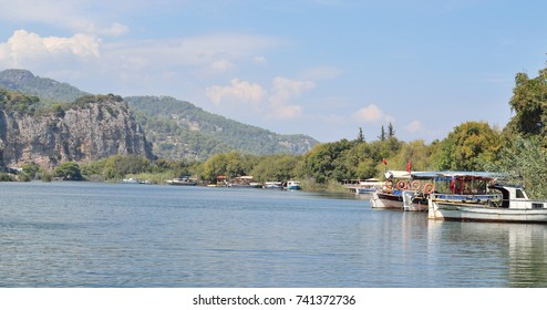 boat for tourists moored along the banks of the Dalaman River in Turkey