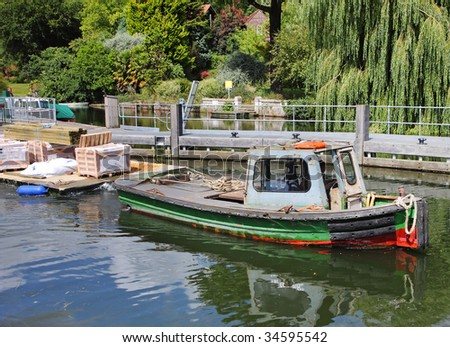 Boat Towing Pontoon Building Supplies Along Stock Photo