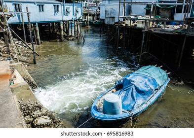 Boat and traditional wooden tall house in Tai O, Hong Kong
