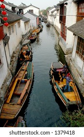 Boat traffic on the narrow river of a southern Chinese town. More with keyword Series11A.