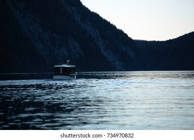 Boat transporting tourists on the lake Königssee in the evening