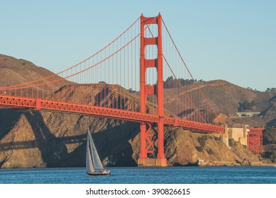 A boat travelling under the Golden Gate Bridge in San Francisco, California, USA