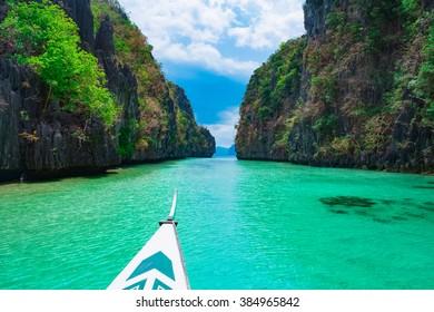 Boat trip in blue lagoon, Palawan, Philippines