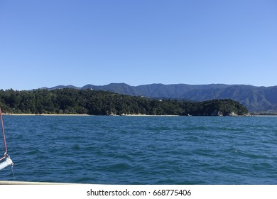Boat trip with a catamaran along the coast of the abel tasman national park, Torrent Bay, Kaiteriteri, New Zealand