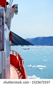boat trip to the Eqip Sermia - Eqi Glacier in Greenland Disko Bay. Many icebergs in the arctic sea. World heritage -  extremly affected by global warming and climate change. Summer - July