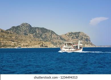 Boat trip in Mediteranean sea near coast of island of Rhodes (Rhodes, Greece)