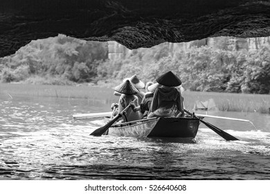 Boat trip on Ngo Dong river in Tam Coc, Vietnam. Silhouette view from inside a cave