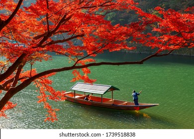 Boat trip on the river under the red maple leaves