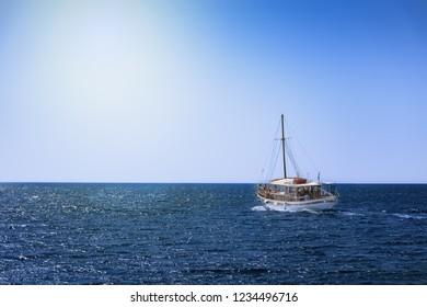 Boat trip in open sea near coast of island of Rhodes (Rhodes, Greece)