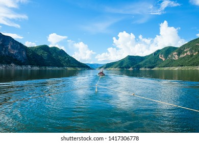 Boat Trip with towing boat at Bhumibol dam in Beautiful day.Tak Thailand.