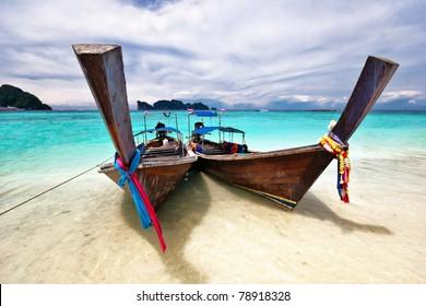 Boat in the tropical sea near the beach. Thailand