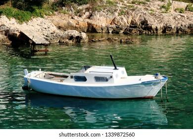 boat in the turquoise sea, Valdarke, island Losinj, Croatia