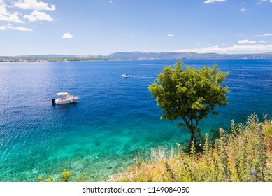 Boat in a turquoise water in a bay near Malinska, Croatia. Summer holidays, travel concept. Boats in Mediterranean Sea. Tourists boats in Adriatic sea.