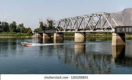 Boat under bridge on Thompson River in Kamloops, British Columbia, Canada