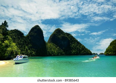 Boat vacation on Tropical Island. This picture taken in one of the most beautiful travel and diving destination on earth. Raja Ampat Island, Papua, Indonesia.