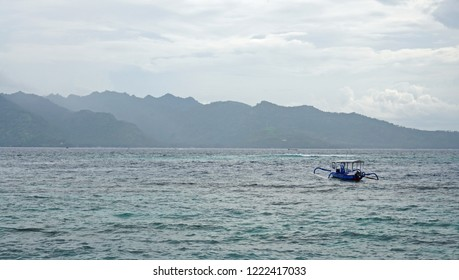 A boat view to Lombok mountains on hazy afternoon seascapes