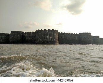 Boat view of the Murud Janjira Fort at sunset built in the ocean in India