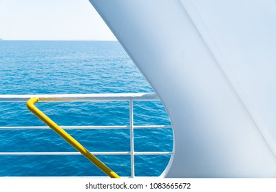 Boat voyage background, ship's safety railing with blue ocean background and horizon behind