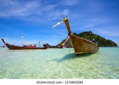 The boat is waiting for tourists at sea in Thailand.