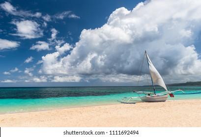 boat at white Puka beach of Boracay island Philippines