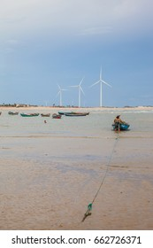 "Boat and wind farm in the background at ""Pedra do Sal"" beach - Paui, Brazil"