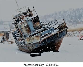 boat in winter Baikal lake