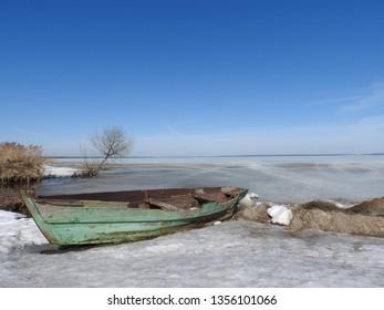 Boat in winter on the shores of lake Pleshcheyevo, Pereslavl Zalessky, Yaroslavl region, Russia on a clear day.