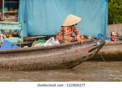 Boat woman in floating market in Mekong River, Vietnam
