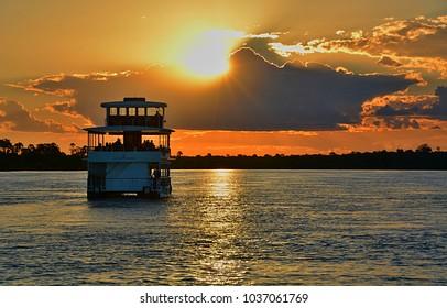 Boat at Zambezi river at sunset