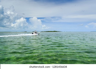 Boaters crossing shallow clear waters of the Florida Keys on their way to lobster hunting grounds in Florida Bay.