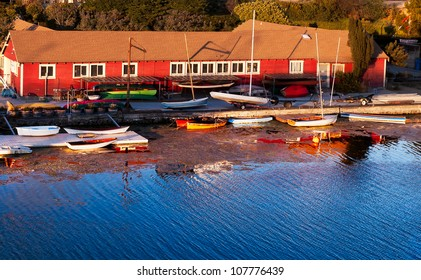 Boathouse in afternoon golden light.  Colorful image.