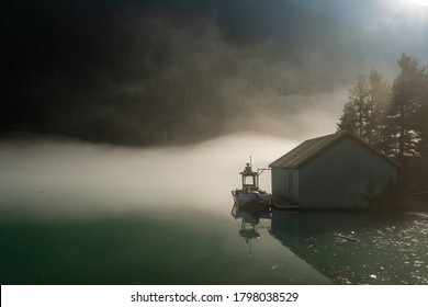 Boathouse isolated on lake with heavy fog mist in the mountains in Northern Cascades Pacific Mountain Range National Park Washington, USA